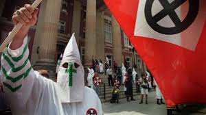 wisconsin teacher removed for essay defending ku klux klan news a member of the ku klux klan waves a flag in mercer pennsylvania in