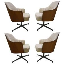 four milo baughman style teak back swivel dining chairs mid century modern from a unique collection of antique and modern dining room chairs at