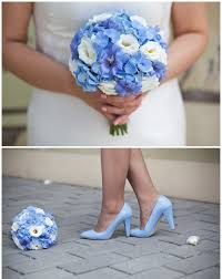 flowers for a beach wedding. wedding bridal bouquet blue white flowers shoes for a beach