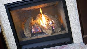 burning wood in gas fireplace gas fireplace with tile surround and hearth wood burning fireplace gas