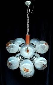 a stunning sputnik style chandelier with 11 art glass globes in various designs made by