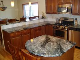 grey granite countertops with brown cabinets