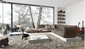 ultra modern living room with brown l shaped sofa big glass window velvet rug and thrilling view image
