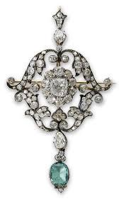 description an antique emerald and diamond pendant