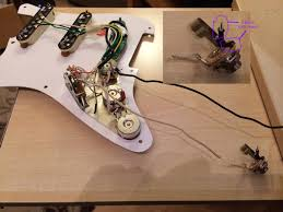 help wiring fender stratocaster guitar forum i m assuming the black lead from volume pot goes to one of the clipped black wires on the output jack where i m confused is the strat also had an earth