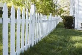 white picket fence. A Decorative White Picket Fence Also Marks Property Line.