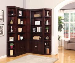 Interior. dark brown wooden Corner Shelf Units with some racks and doors  connected by beige