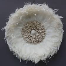 interior juju hat wall hanging large white round tan pretty african feather headdress flag colors american