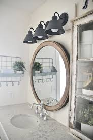 see how to make this super simple farmhouse bathroom vanity light fixture on a budget bath vanity lighting fixtures
