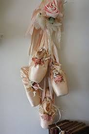 pink worn ballet point shoes wall