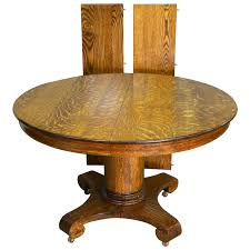 antique round oak empire dining table maine antique furniture ruby lane