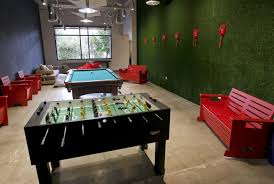 cool office games. A Pool Table And Foosball Sit Next To Nonfunctional Phones On Display As Joke Cool Office Games