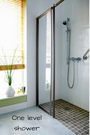 small walk in shower with a one level bathroom floor
