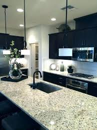 dark cabinets light countertops compact contemporary kitchen with