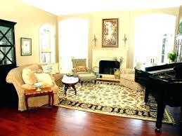rug on carpet living room area top of over pad home depot rugs