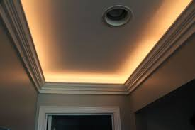 rope lighting in tray ceiling. narrow tray ceiling illuminated with rope lighting and designed crown molding in a