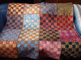 "When Making a Quilt, ""Fluff-Factor"" Matters & Squares in a Square finished quilt Adamdwight.com"