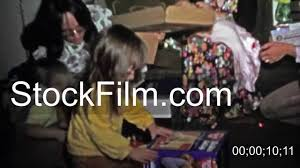 1973 kids opening gift toys with flower dresses around boulder co usa