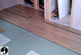 how install laminate flooring over the top kitchen uncovered started laying reclaimed timber planks pine wood