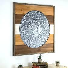 framed iron wall art metal framed wall art framed metal medallion on wood wall hobby lobby