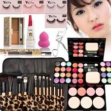 a set of makeup tool with eyebrow cream eyeshadow eyelash blush palette powder beauty useful cosmetic