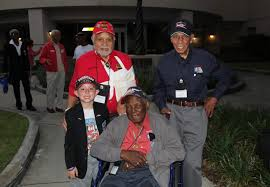 the little boy the big heart for the tuskegee airmen caf  quinn thorne original tuskegee airmen from top left leo gray dr roscoe brown and the late calvin spann