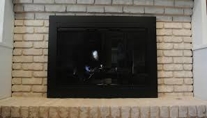furniture cool glass fireplace door brackets with black steel fireplace door at brick wall fireplace