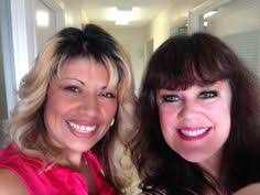 Two of the ladies from Looney & Conrad...(l-r) Cynthia Zamora and ...