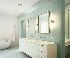led bathroom lighting vanity with two framed mirrors above double sink bathrom vanity and green