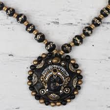 hand painted black and gold ceramic durga dess necklace divine durga in black