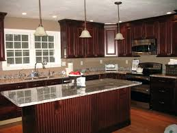 Kitchens With Cherry Cabinets Best Glass Tile Backsplash Cherry Cabinets Kitchen Black Counter
