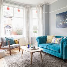 blue sofa living room. Be Inspired By A Living Room Anchored Bold Blue Sofa H
