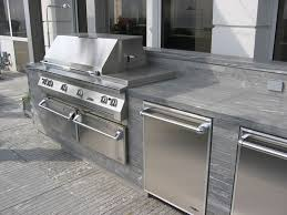 image of grill with blue stone countertop