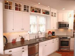 Decorating Above Kitchen Cabinets Tips For Decorating Above Kitchen Cabinets Amys Office