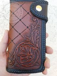 a long wallet with some western style tooling on it hand tooled dyed and laced branding custom leather wallets