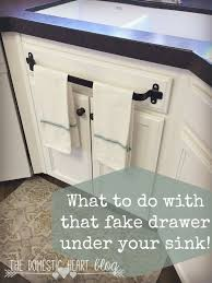 kitchen towel holder. What To Do With That Fake Drawer Under Your Kitchen Sink. Cabinet Towel Bar And Other Hacks At The Domestic Heart Blog. Holder A