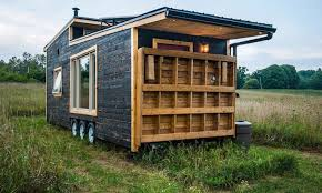 the tiny house is also wired with a 4 speaker integrated sound system the bathroom contains a full size standup shower sink and composting toilet