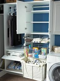blue laundry room with white cabinetry and wire baskets