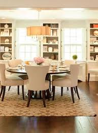 elegant dining room boasts a brown scalloped chandelier rittenhouse fabric pendant chandelier over a