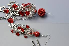 then attach an earring hook to the loop of the headpin finally repeat the same ways to make another star chandelier earrings