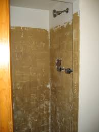 image of shower stall with ugly blue tile removed