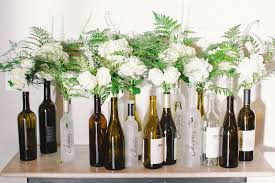 White Flowers in Wine Bottles