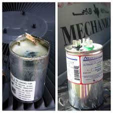 air conditioning capacitor. left - blown capacitor right new air conditioning