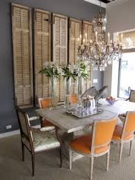 reclaimed shutters as dining room wall decor