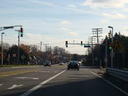 lakewood road turns into nj 166 as us 9 joins the garden state parkway nj 444 it runs south as a two lane undivided road there are traffic lights at