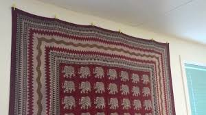 how to hang a tapestry on wall without