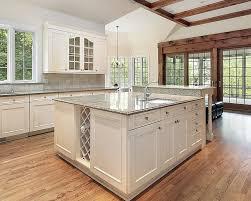 Gray granite and white cabinet kitchen island