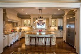 white traditional luxury kitchen with rich wood flooring in u shape with center island
