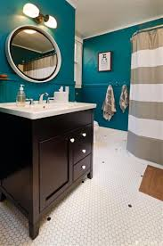 bathroom petrol walls wood furniture and doors white wall tiles porcelain black or dark grey checd tiles for the floor