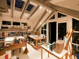... loft interior of home art studio with track lights and hardwood  crafting table ...
